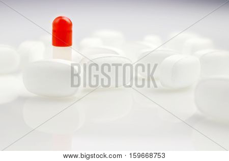 Pharmacy theme. Red and White Isolated Pills and Capsules on the White Surface. Closeup