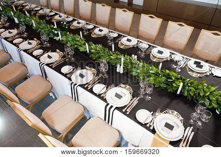 Wedding decor. Wedding interior. Festive decor. Table decor. Table layout. Restaurant interior.