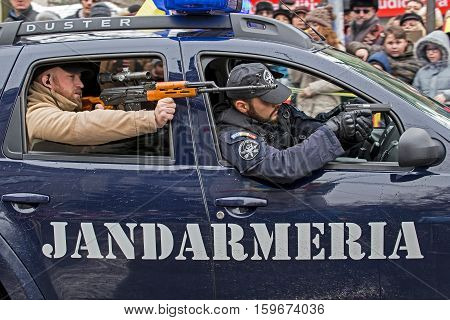 TIMISOARA ROMANIA - DECEMBER 1 2016: Military parade at Romanian National Day. Cops from gendarmerie simulating a mission. Picture taken in front of the Administrative Palace in Timisoara.