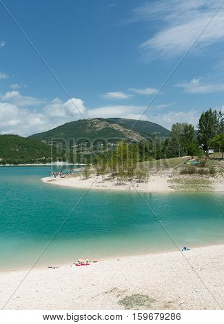MACERATA ITALY- AUGUST 19: undefined people on the beach at Fiastra artificial lake on august 19 2016 in Macerata - Italy