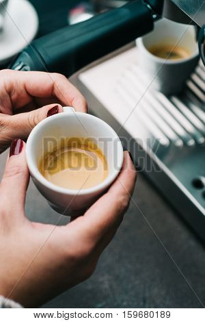 Freshly made espresso in small white cup