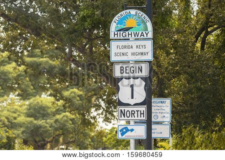 Key West, Florida - October 17, 2016: Florida Scenic Highway Sign in Key West, Florida, USA. Mile Zero Sign is the starting point of U.S. Route 1 in Key West.