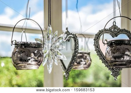 decoration wind chime hanging next to window