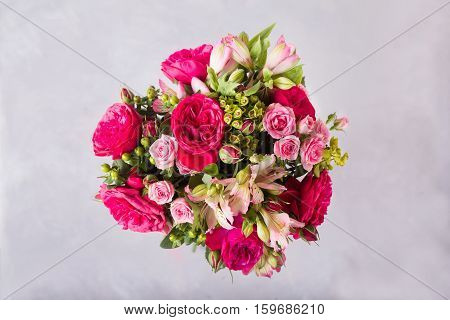 Bouquet of red, pink roses and pink peonies, alstroemeria. . Still life with colorful flowers. Fresh roses. Place for text. Flower concept. Fresh spring bouquet. Summer Background