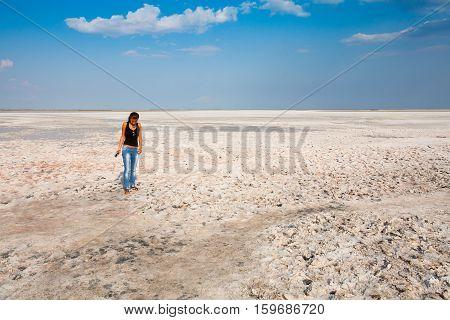 A girl stands on a white bottom of a dried-up salt lake. Siwash. Crimea. 2011-09-04 16:20:29