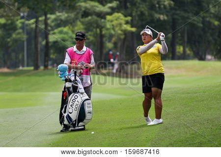 KUALA LUMPUR, MALAYSIA - OCTOBER 29, 2016: Amy Yang of South Korea checks the checks the fairway of the TPC Golf Course at the 2016 Sime Darby LPGA Malaysia golf tournament.