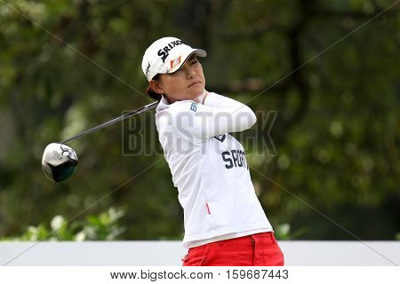 KUALA LUMPUR, MALAYSIA - OCTOBER 29, 2016: Sakura Yokomine of Japan tees off from the T-box of the 4th hole at the TPC Golf Course at the 2016 Sime Darby LPGA Malaysia golf tournament.