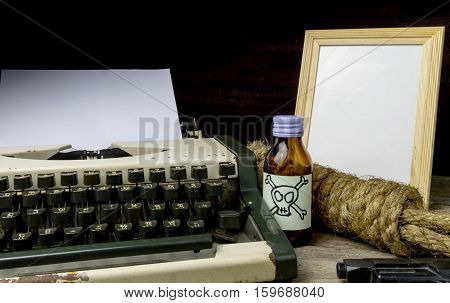 Typewriter with paper page and poison and gun. Concept writer Romance Suspense