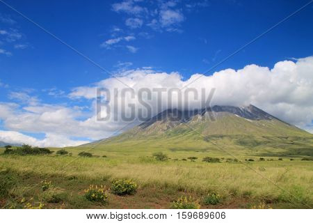 Save Download Preview Ol Doinyo Lengai (Mountain of God in the Maasai language) an active volcano in the Northern Tanzania