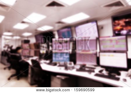 Blurring of man operated plant control room and computer monitors for operate and monitor process in miniature tone with vintage style.