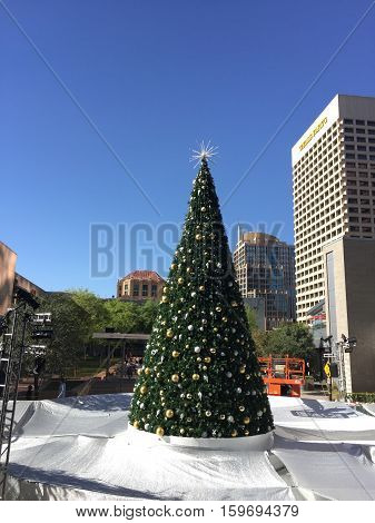 PHOENIX AZ - NOVEMBER 17 2016: Silver-White reflective tarp covering downtown city skating ring with decorated Christmas tree in warm and sunny Phoenix Arizona