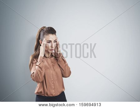 Woman Is Stressed Near A Gray Wall