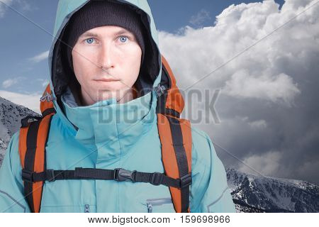 Hiker man in winter mountains.