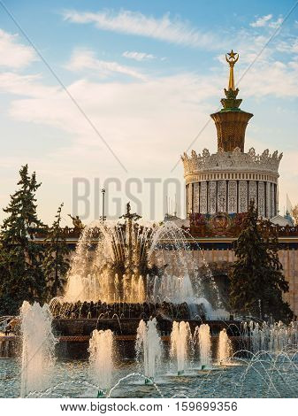 Fountain in the park at the Exhibition of Economic Achievements in Moscow in the evening