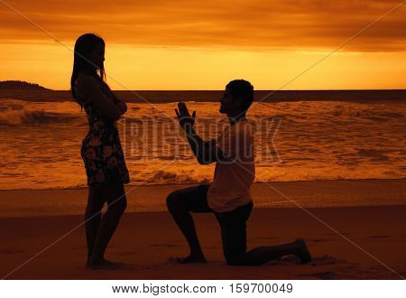 Apology of a young man outdoor at sunset