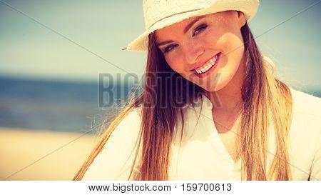 Female Tourist Resting On Beach.