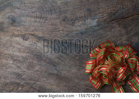 Decorative red and gree ribbon on wooden background for christmas and new year card