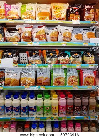 CHIANG RAI THAILAND - NOVEMBER 25: various brand of burger and pasteurized milk in packaging for sale on supermarket stand or shelf in Seven Eleven on November 25 2016 in Chiang rai Thailand.