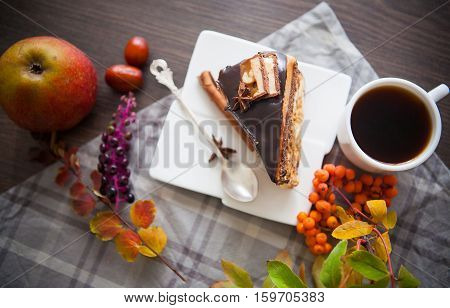 piece wof sweet brownie with chocolate with coffee
