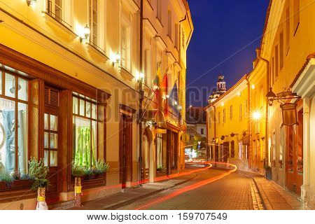 Picturesque Street at night in Old Town of Vilnius, Lithuania, Baltic states.