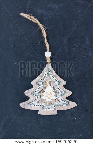 Decorative handmade christmas tree on black wooden background