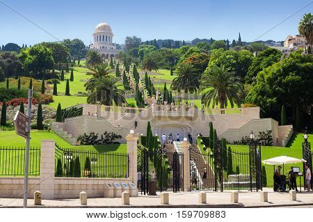 HAIFA ISRAEL - CIRCA SEP 2016: Bahai Gardens. Tourists walk on the terrace. View from the lower gate