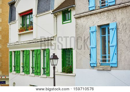 Parisian Buildings With Green And Blue Window Shutters