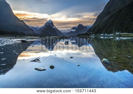 Sunrise and reflection at Mitre Peak Milford Sound in Fiordland National Park New Zealand