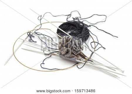 making knitted pompom with many needles isolated on white
