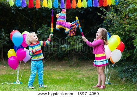 Kids Playing With Birthday Pinata