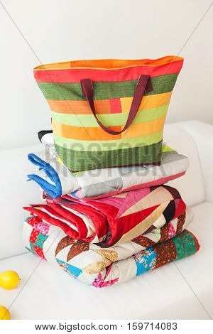 Patchwork bag on a white background. Bag from fabric on a white background. Patchwork quilt on a white background. Color patchwork bag. White isolate.
