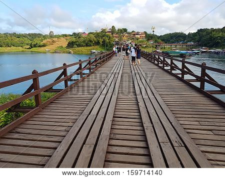 KANCHANABURI THAILAND - NOVEMBER 25: the old wooden Mon Bridge in Sangkhla Buri on November 25 2016 in Kanchanaburi Thailand