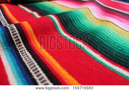 Mexico poncho serape traditional fiesta background with stripes copy space