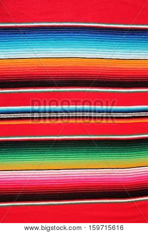 Mexico traditional cinco de mayo rug poncho fiesta background with stripes copy space poster