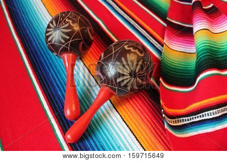 Mexico poncho serape traditional cinco de mayo rug maracas fiesta background with stripes copy space
