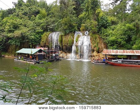 KANCHANABURI THAILAND - NOVEMBER 26: unidentified tourist in floating houses playing at Sai Yok Yai waterfall on Khwae Noi River on November 26 2016 in Kanchanaburi Thailand