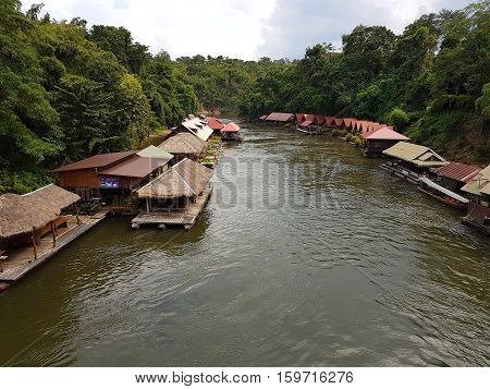 KANCHANABURI THAILAND - NOVEMBER 26: floating houses and restaurants at Kwae Noi river on November 26 2016 in Kanchanaburi Thailand