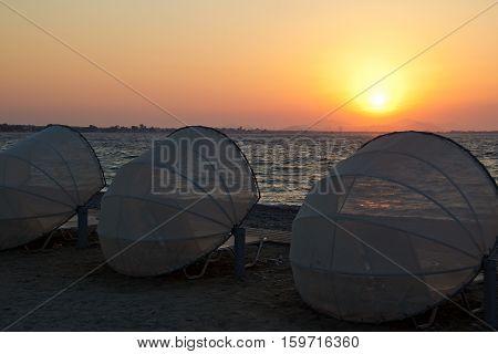 Sunset on the pebbles beach / Beach on the island of Kos (Greece). Aegean sea.