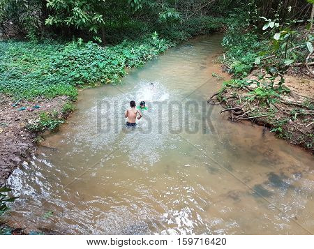 KANCHANABURI THAILAND - NOVEMBER 26: unidentified asian people swimming in the Sai Yok Yai waterfalls on November 26 2016 in Kanchanaburi Thailand