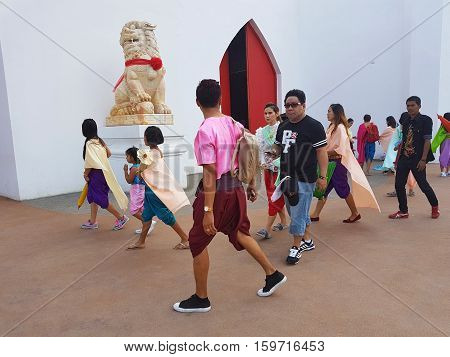 KANCHANABURI THAILAND - NOVEMBER 26: unidentified asian people wearing Thai traditional clothing at Malika R.E.124 on November 26 2016 in Kanchanaburi Thailand. Malika R.E.124 is the newest attraction place of Kanchanaburi Province