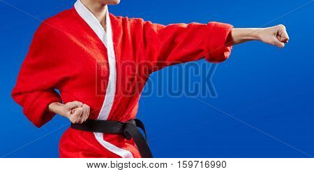With black belt the sportswoman beats punch arm