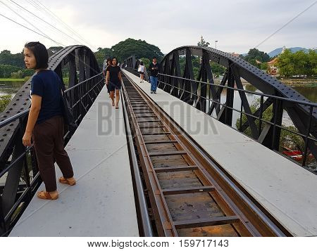 KANCHANABURI THAILAND - NOVEMBER 26: unidentified asian woman standing on Bridge on the river Kwai on November 26 2016 in Kanchanaburi Thailand