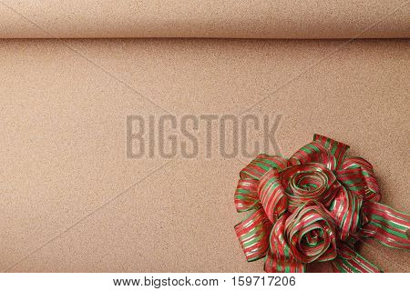 Decorative red and gree ribbon on brown paper background for christmas and new year card vintage tone