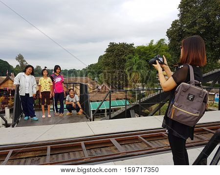 KANCHANABURI THAILAND - NOVEMBER 26: unidentified asian people taking photograph on Bridge on the river Kwai on November 26 2016 in Kanchanaburi Thailand