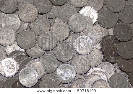 Russian coin five rubles, in large quantities. on coins background