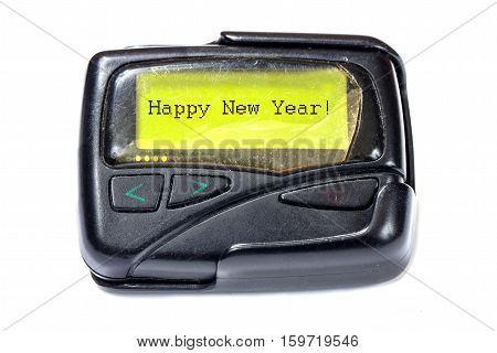 Old pager on a white background. The message on the screen: Happy New Year!