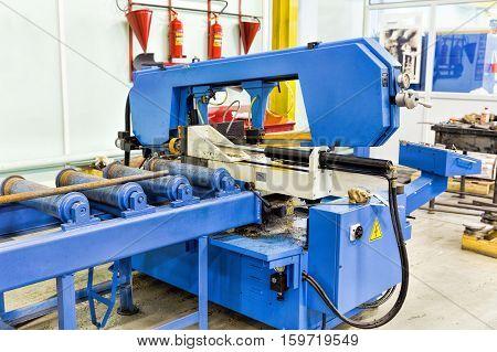Semi auto band saw in mechanical workshop