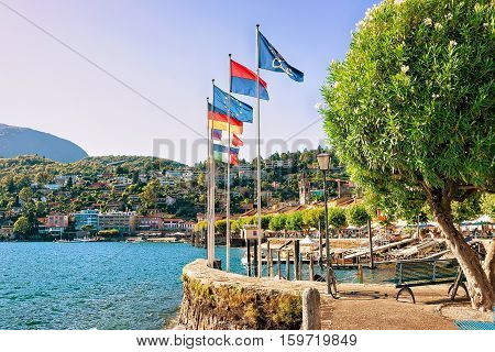 Flags at the luxurious resort in Ascona on Lake Maggiore in Ticino canton in Switzerland.