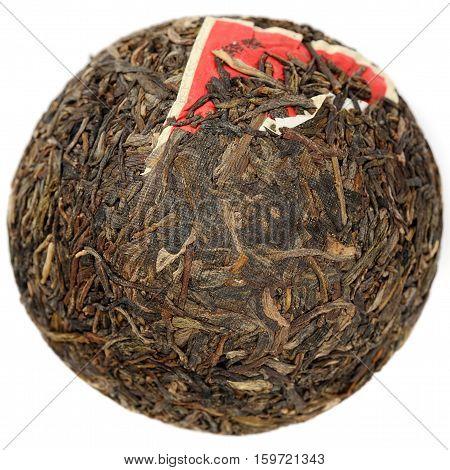 Raw puerh tea tuocha shape isolated overhead view