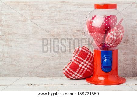 Valentine's day concept with hearts inside gumball machine
